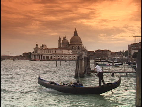A gondolier steers a gondola into the choppy waters in front of Saint Marks Square on the Grand Cana Footage