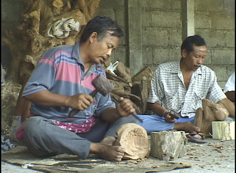 Asian men work diligently with wood-working tools Footage