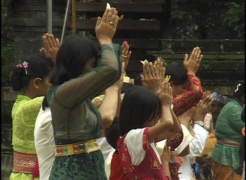 A group of girls stand together in prayer with their... Stock Video Footage