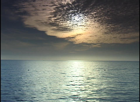 The sun shines through thin layers of clouds and shimmers... Stock Video Footage