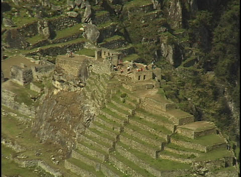 The ruins of Machu Picchu rest against in a steep... Stock Video Footage