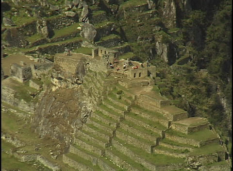 The ruins of Machu Picchu rest against in a steep mountain hillside in Peru Footage