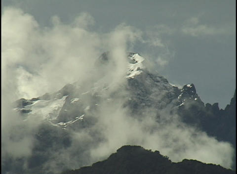 White clouds float over the peaks of the Andes mountains Stock Video Footage