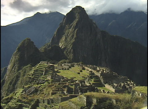 The ancient ruins of Machu Picchu lie in the mountain hillsides of Peru Footage