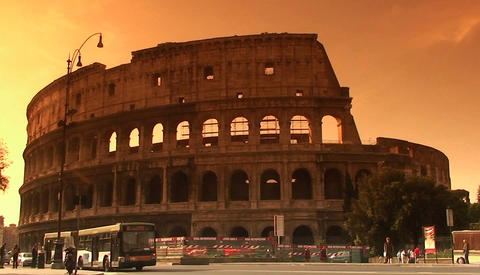 The Coliseum in Rome with traffic passing Footage