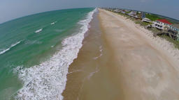 Aerial of empty beach and beach homes Footage