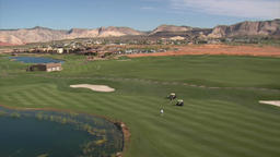 Aerial shot of golfers on desert course Footage