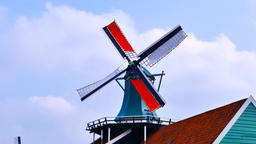 Classic Dutch windmill at Famous tourist location of Zaanse Schans at the outski Footage