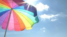 Bright beach umbrella and sun Footage