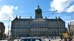 Dam square on a sunny day with locals and tourists at the square and transportat Footage