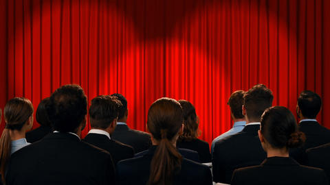 Business people in a theatre watching encouraging words Animation