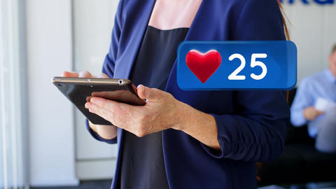 Heart icon and a woman using a digital tablet Animation