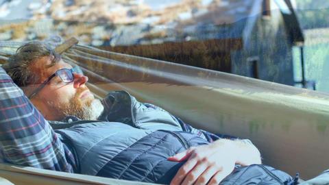 Man lying on a hammock in a farm Animation