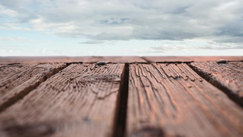 Wooden deck with a view of cloudy skies Animation