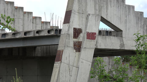 Derelict unbuilt stadium construction ruins in city, zoom out Live Action