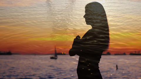 Silhouette of a woman beside an ocean Animation