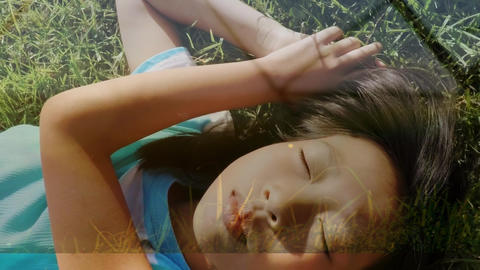 Little girl lying on grass Animation