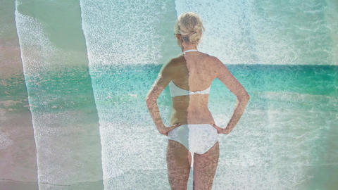 Woman wearing a bathing watching the waves Animation