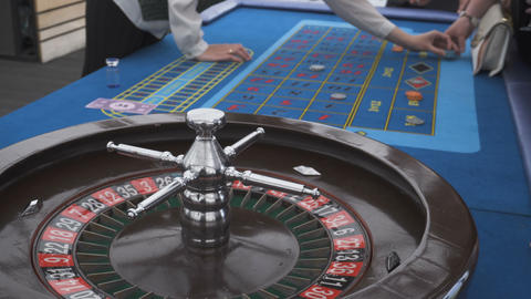 Roulette and piles of chips on a table Live Action