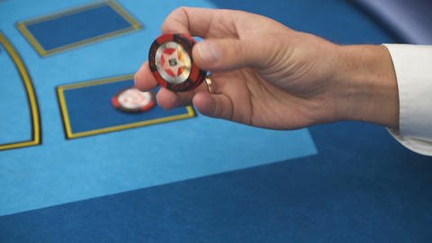 Casino player holding a chip Live Action