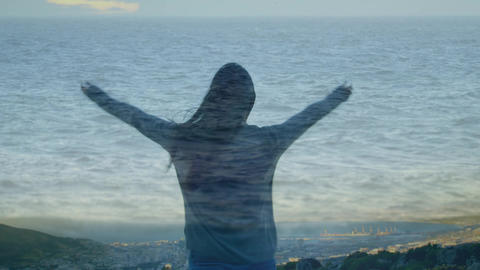 Woman raising her hands over the sea Animation