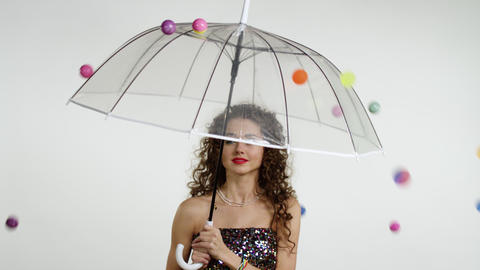 Young beautiful woman with an umbrella Live Action