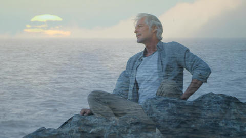 Old man sitting on rocks and a view of the sea Animation