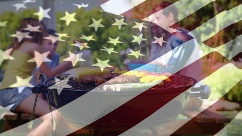 Family enjoying a picnic and the American flag for fourth of July Animation