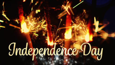 The words Independence Day with lit sparklers Animation