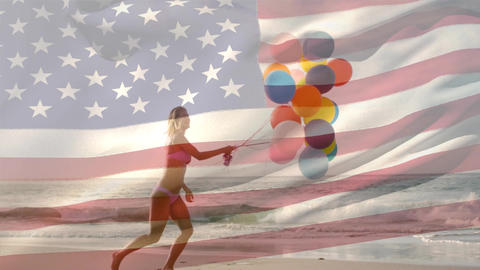 Woman holding balloons in the beach and the American flag for fourth of July Animation