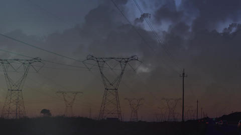 Transmission towers and lightning in clouds Animation