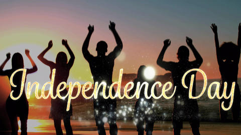 Independence day text and silhouette of people jumping by the beach during sunset Animation