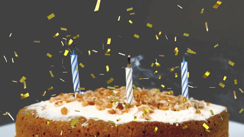 Birthday candles on a cake and confetti Animation