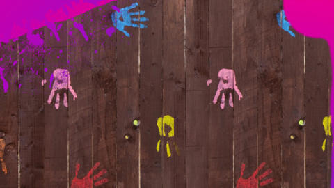 Pink paint covering handprints on wooden boards Animation