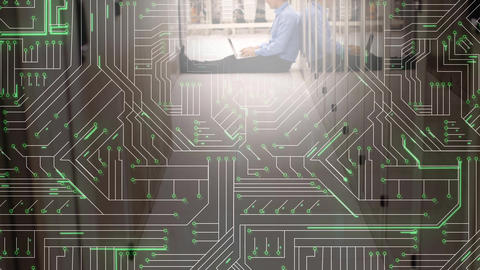 Man using laptop in server room and glowing circuit board Animation