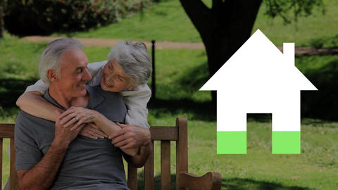 Senior couple outdoors and house iocn filling green Animation