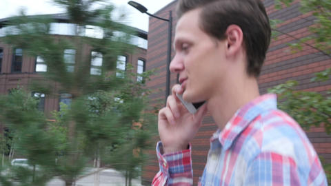 Excited Walking Man Talking on Phone, Walk in Parking Area Live Action