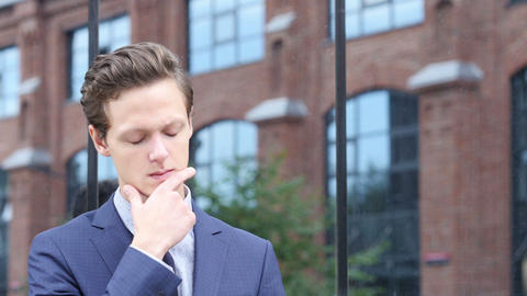 Thinking Pensive Young Businesman , Outdoor Brainstorming Footage