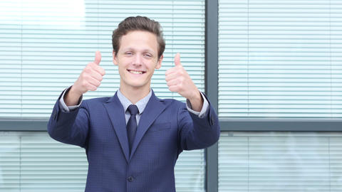 Thumbs Up by Young Businessman with Both Hands Footage