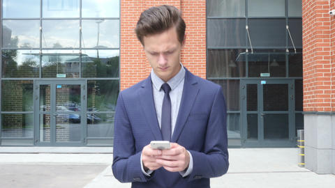 Walking Businessman Typing Text Message on Smartphone, Email, Outdoor ビデオ
