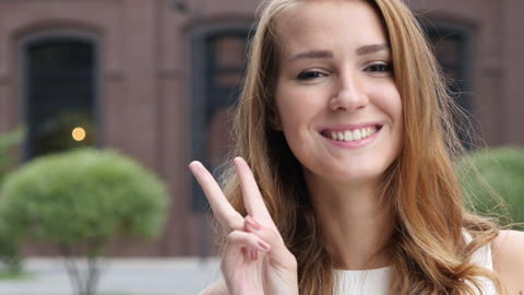Sign of Victory by Beautiful Girl Face, Outdoor Portrait Footage