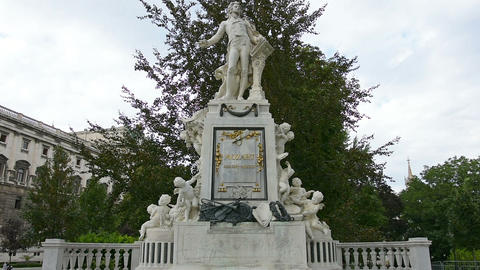 the statue of Mozart in Burggarten park in Vienna Live Action