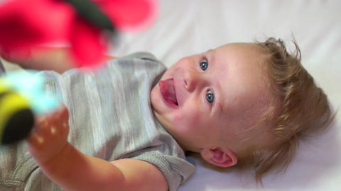 Happy Infant Baby Newborn Child Smiling In Crib Bed Cradle Footage