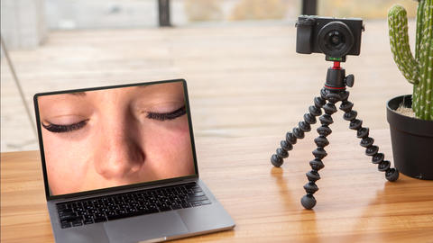 Zooming video on laptop with footage on screen with eyes of beauty girl Live Action