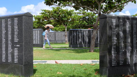 Japanese Woman Visiting The Cornerstone Of Peace In Okinawa Japan Live Action