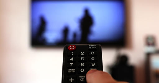 Man Watching TV And Changing Channels With Remote Live Action