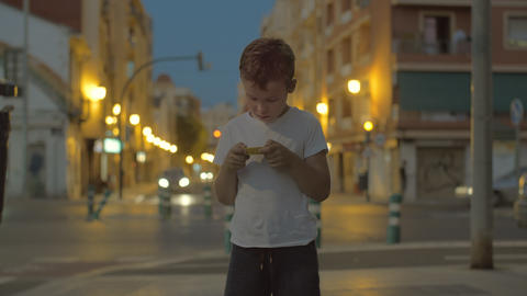 Child with maze toy outside in the evening Live Action