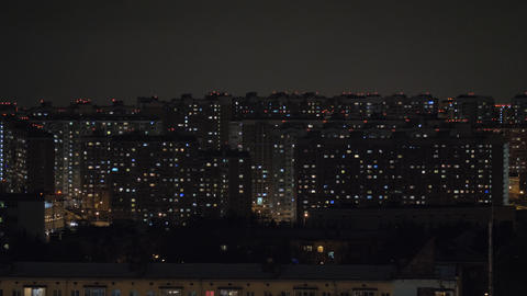 Night city illuminated with lights in apartment blocks. Moscow, Russia Acción en vivo
