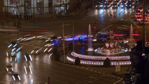 Timelapse of transport traffic on Plaza de Cibeles in night Madrid, Spain Live Action