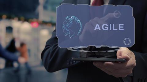 Businessman uses hologram Agile Live Action